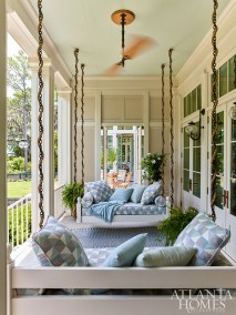 A pair of bed swings off the master bedroom provide a breezy retreat for midafternoon naps, while a louvered door allows for both privacy and connection to the adjoining rear porch.