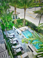 White Elephant Palm Beach has a crisp white exterior and a petite, palm-shaded plunge pool.