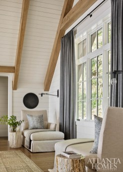 """""""It's a breakout space from the bedrooms,"""" says Millner of the loft, pictured and opposite. """"Their guests go up there to have their coffee without having to be in the main living space."""" She and Moorhouse added chaise lounges from Lee Industries and pillows in a fabric by Clay McLaurin Studio."""