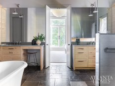 French limestone flooring, custom oak cabinetry and concrete countertops contribute to the five-star spa-like ambiance in the master bathroom.