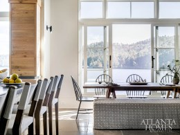 """Raised up off the floor like a window would be, a set of sliding doors in the breakfast area can be opened to let the breezes in. """"It's like being on a houseboat,"""" says interior designer Carolyn Malone."""