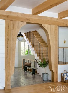 A unique archway composed of white oak timbers signals a transition from the foyer to the main living spaces, says architect J. Ryan Duffey.