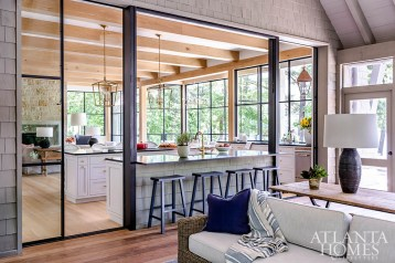 As the homeowners frequently entertain between the kitchen and porch, the Duffeys were keen to provide them with a seamless experience. Their solution was pocket doors as well as a steel-and-glass window above of the island that can be fully recessed into the ceiling. All of the home's steel windows and doors were sourced from RG Ironworks.
