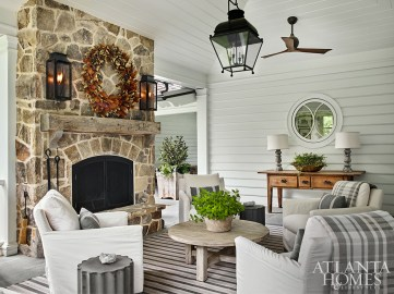 The side porch is one of the homeowners' favorite spots year-round, thanks to a stone fireplace.