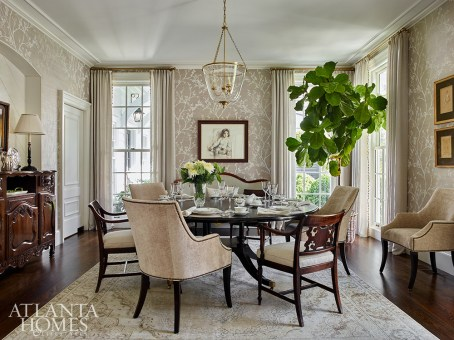 In the formal dining room, a Schumacher wallcovering adds visual verve. The upholstered dining chairs are Bernhardt, upholstered in a Cowtan & Tout linen velvet. The wood dining chairs are antique, upholstered in a Rose Tarlow fabric.