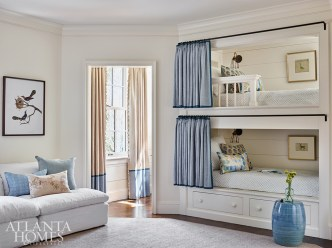 """For the clients' young daughter, Askins and Bozeman fashioned a playful bunk room. """"It's a fun, inspiring space where she can create, study or unwind,"""" says Bozeman. """"It's also designed so that as she grows up, the space can feel like a place for guests and an office rather than a little girl's bunk room."""""""