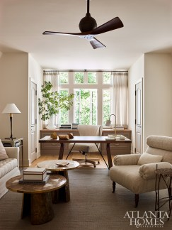Sheer fabric from Rogers & Goffigon filters the sunlight in the husband's den, which is furnished with plush upholstered pieces and a sculptural white oak desk by Liaigre through R Hughes.