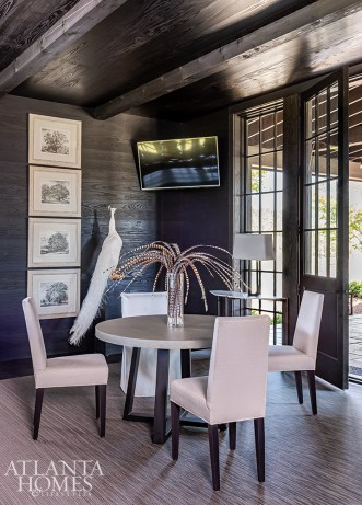 Soft upholstered chairs and vintage tree etchings from Nicholson Gallery temper the kitchen dining area's cozy corner.