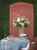 The tall arrangement of summer peonies by Kirk Whitfield spills out over the dessert table.