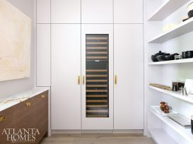 pantry with full sized wine fridge