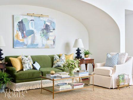 media room with green velvet sofa