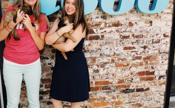 Anna Morgan and Laura Newsome cuddle foster pups at Nebo.