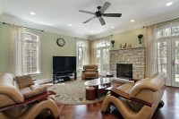Family-living-room-with-stacked-stone-fireplace-flatscreen ...