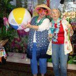 Grandmother and granddaughter toss beach ball playfully