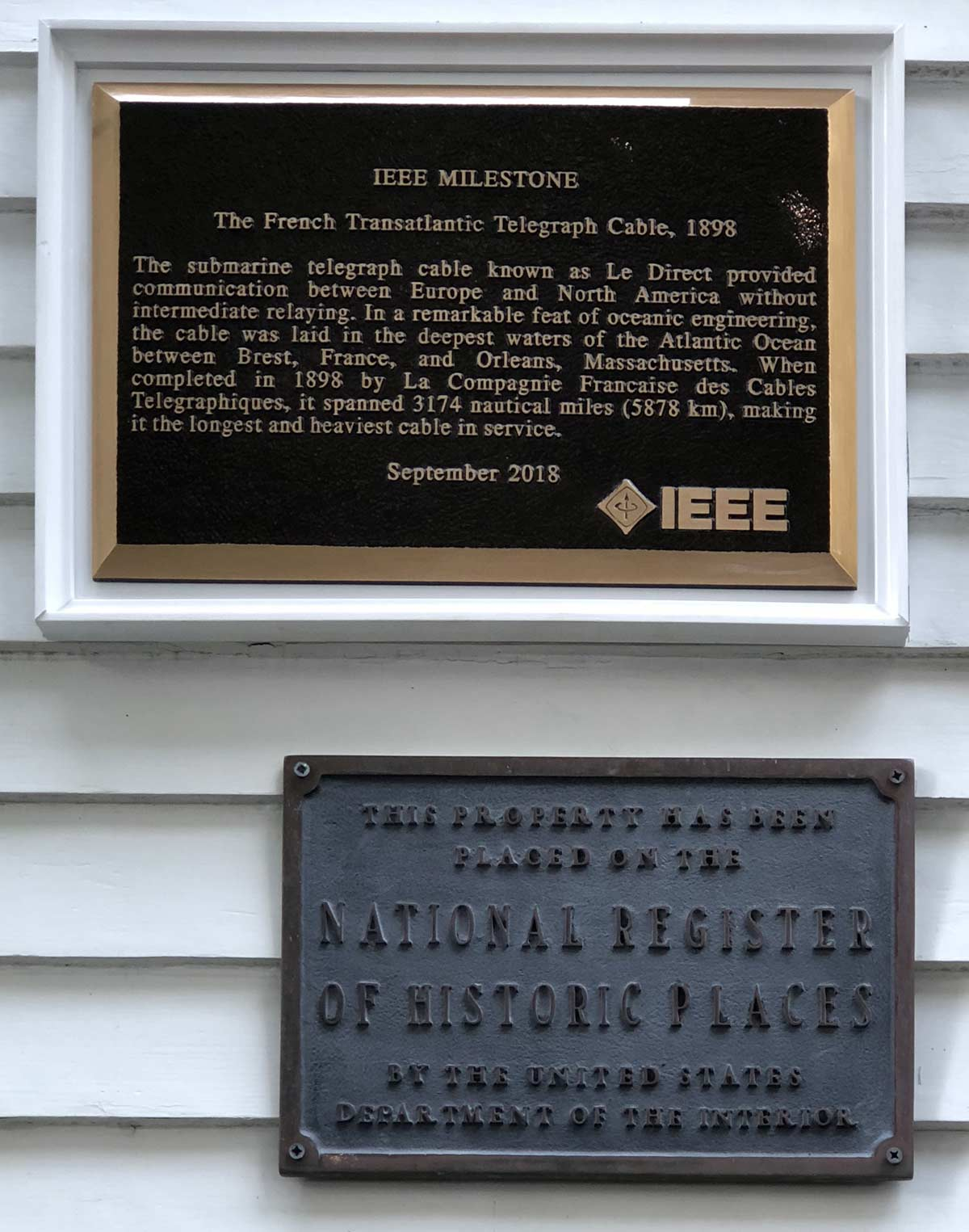 hight resolution of the milestone plaques one in english and one in french were installed one on each side of the main entrance to the museum where they joined the original