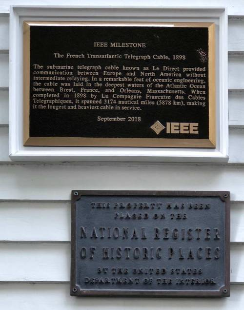 small resolution of the milestone plaques one in english and one in french were installed one on each side of the main entrance to the museum where they joined the original
