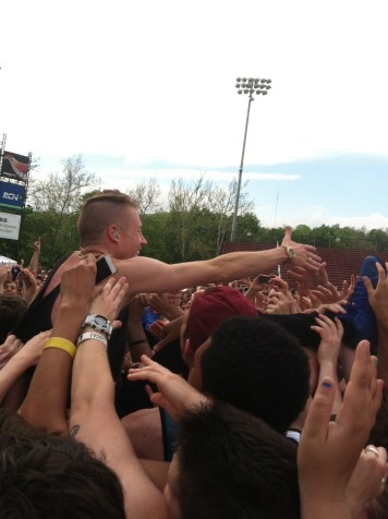 Macklemore climbs into the crowd.