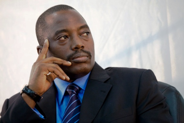 President Kabila looks on during signature ceremonies.