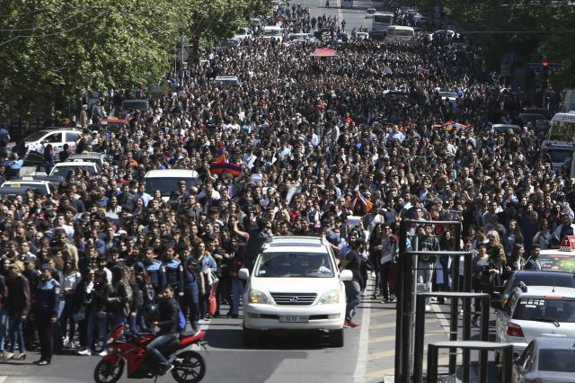 People march during a protest against the appointment of ex-president Serzh Sarksyan as the new prime minister in Yerevan