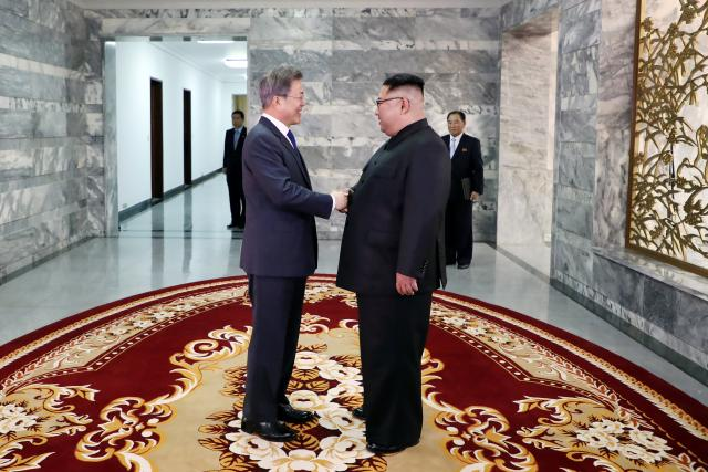 South Korean President Moon Jae-in shakes hands with North Korean leader Kim Jong Un during their summit at the truce village of Panmunjom