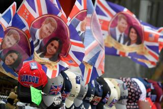 Flags are seen for sale ahead of the forthcoming wedding of Britain's Prince Harry and his fiancee Meghan Markle, on Oxford Street in London, Britain