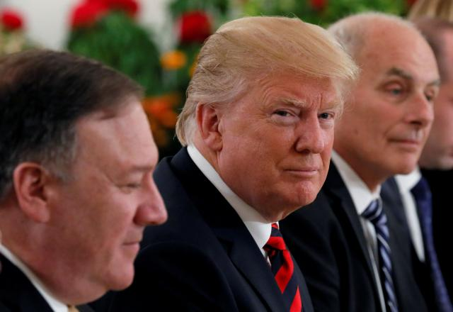 U.S. President Trump flanked by Secretary of State Pompeo and White House Chief of Staff Kelly attend a lunch with Singapore's Prime Minister Lee in Singapore
