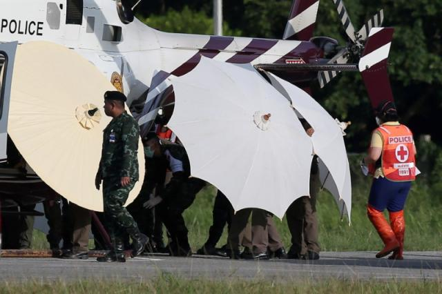 Rescued schoolboys are moved from a Royal Thai Police helicopter to an awaiting ambulance at a military airport in Chiang Rai