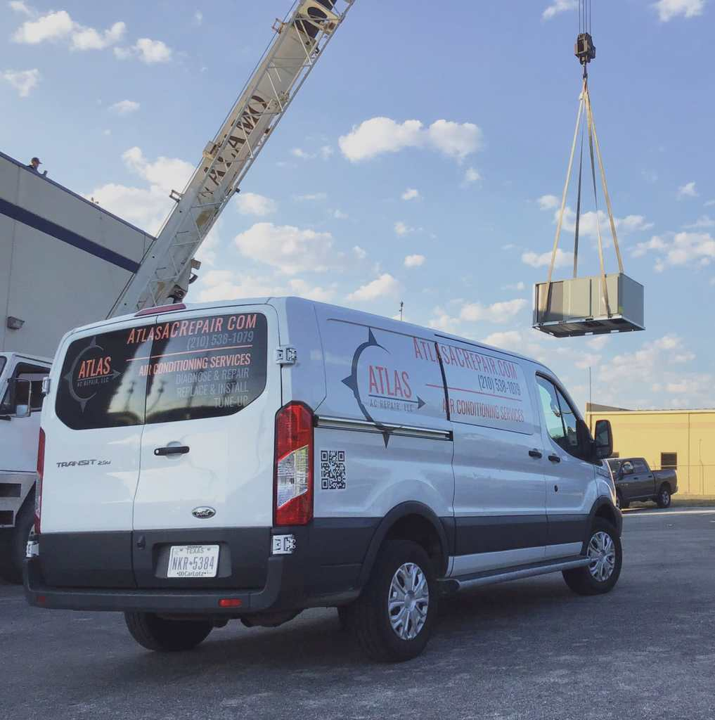 Atlas AC company van at commercial AC replacement