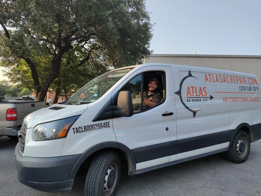 Atlas technician giving thumbs up sign from company van