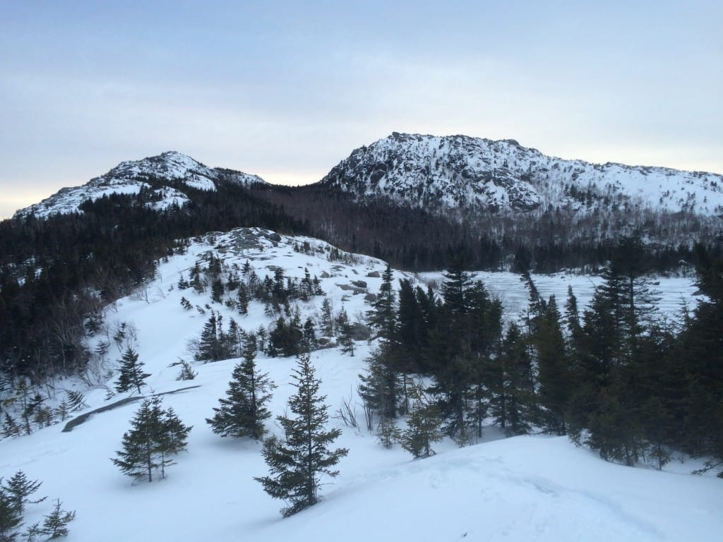 A snowy view of Tumbledown Mountain and Pond.