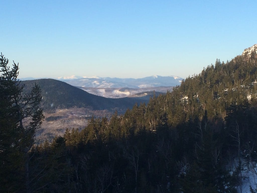 A view of distand mountain ranges from Tumbledown Pond.