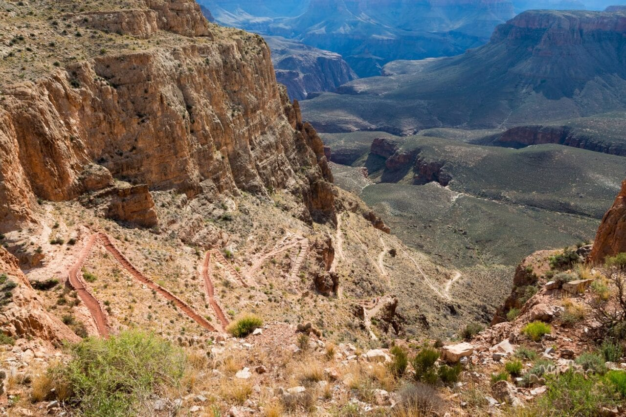 A series of steep switchbacks descends along the South Kaibab Trail toward the Vishnu Basement Rocks in the Grand Canyon.