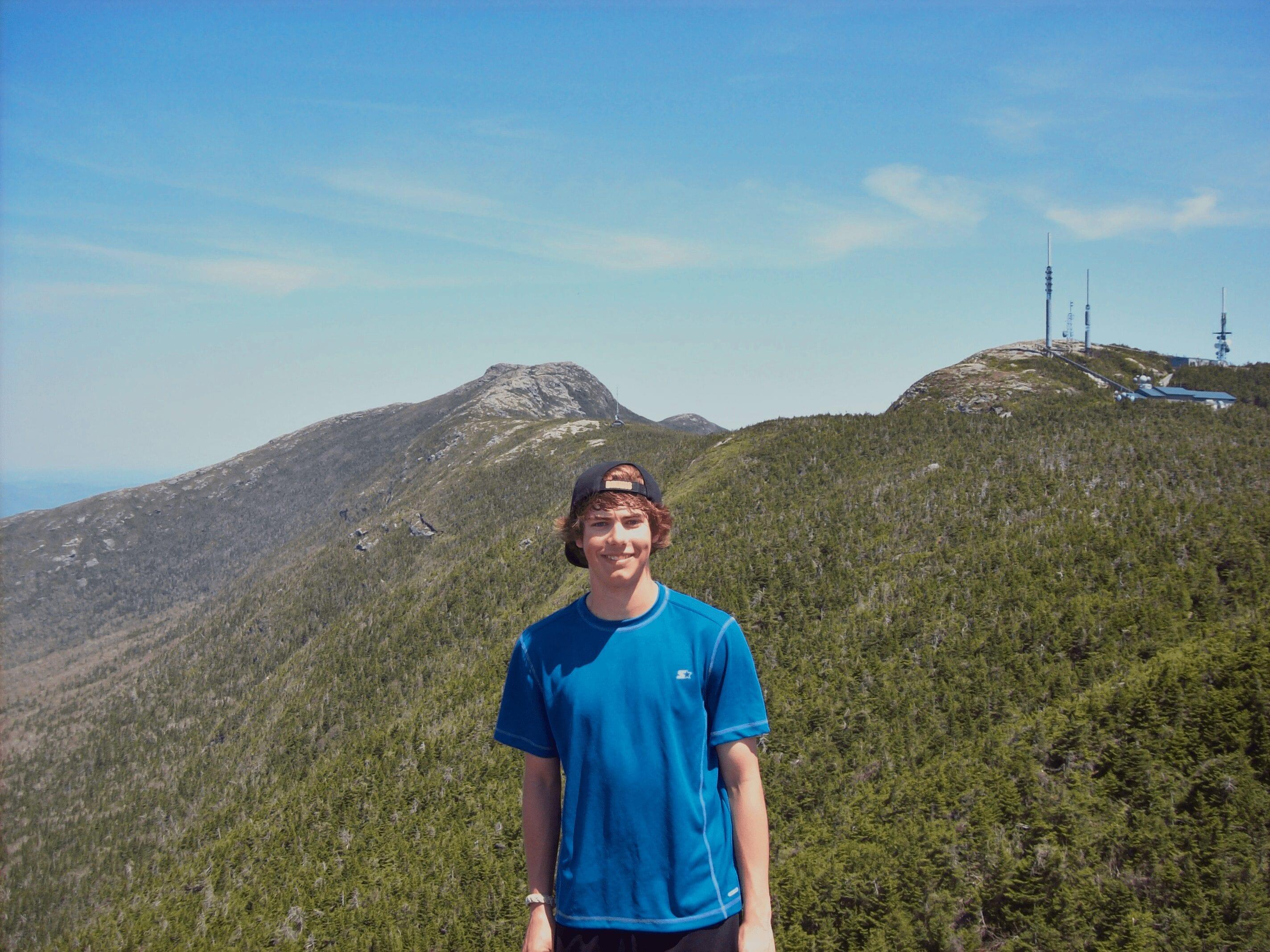 A teenage boy hiking.