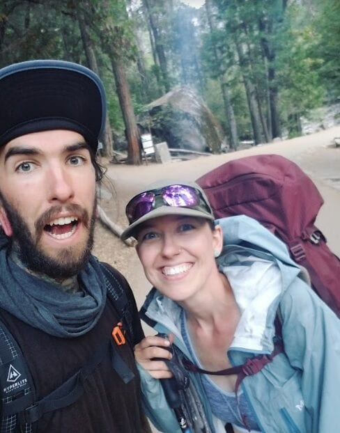 Two hikers smiling on the Appalachian Trail.