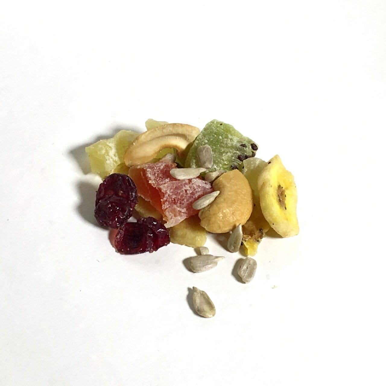 A pile of GORP trail mix including sunflower seeds and fruit.