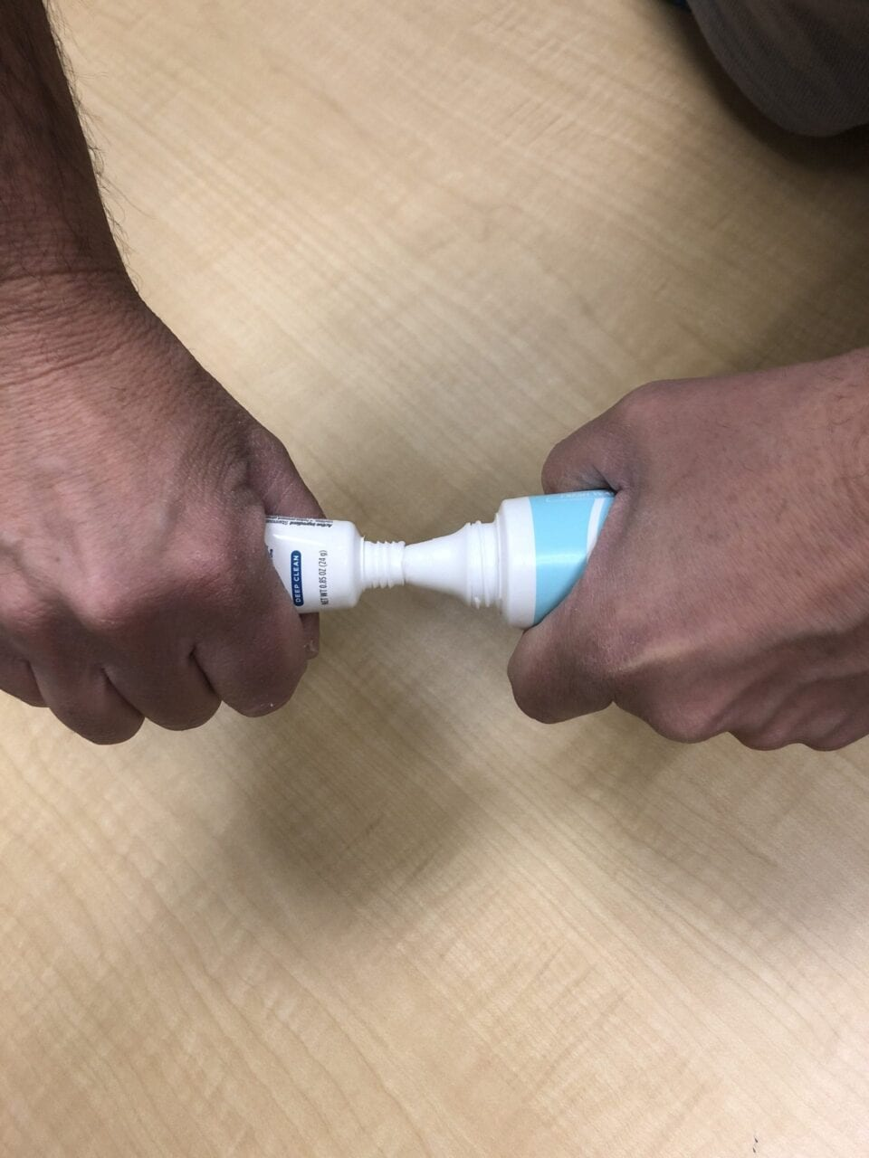 Squeezing one toothpaste into another toothpaste tube.
