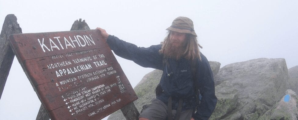 Guthook standing next to the Mount Katahdin sign.