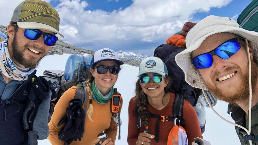A group pf hikers smiling on the Pacific Crest Trail.