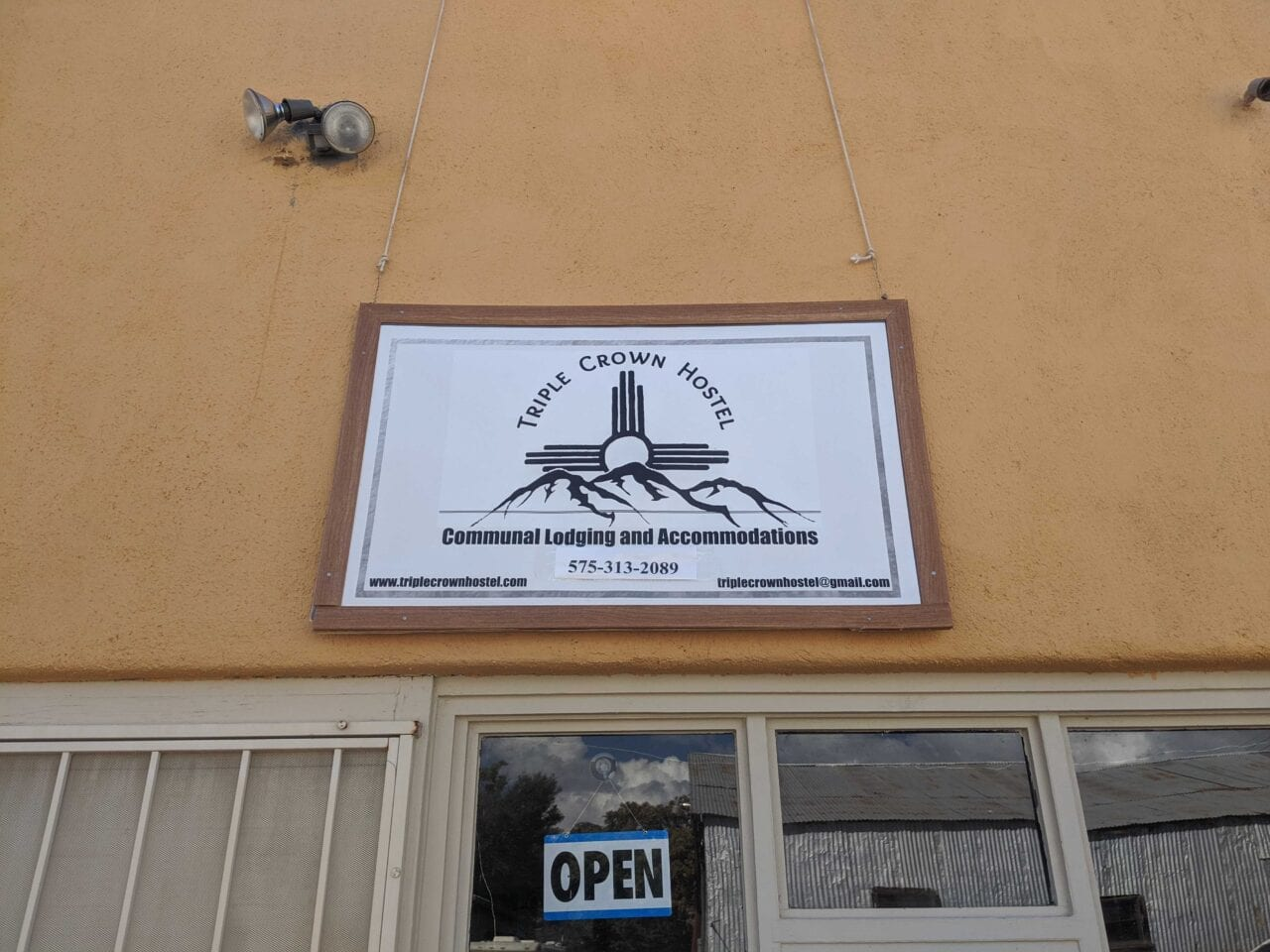 Triple Crown Hostel sign