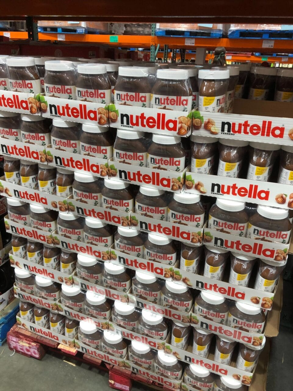 A huge stack of nutella on a pallet at Costco.
