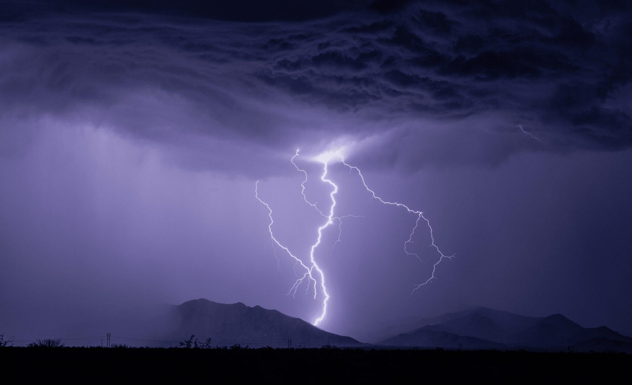 A lightning strike on a dark mountain.