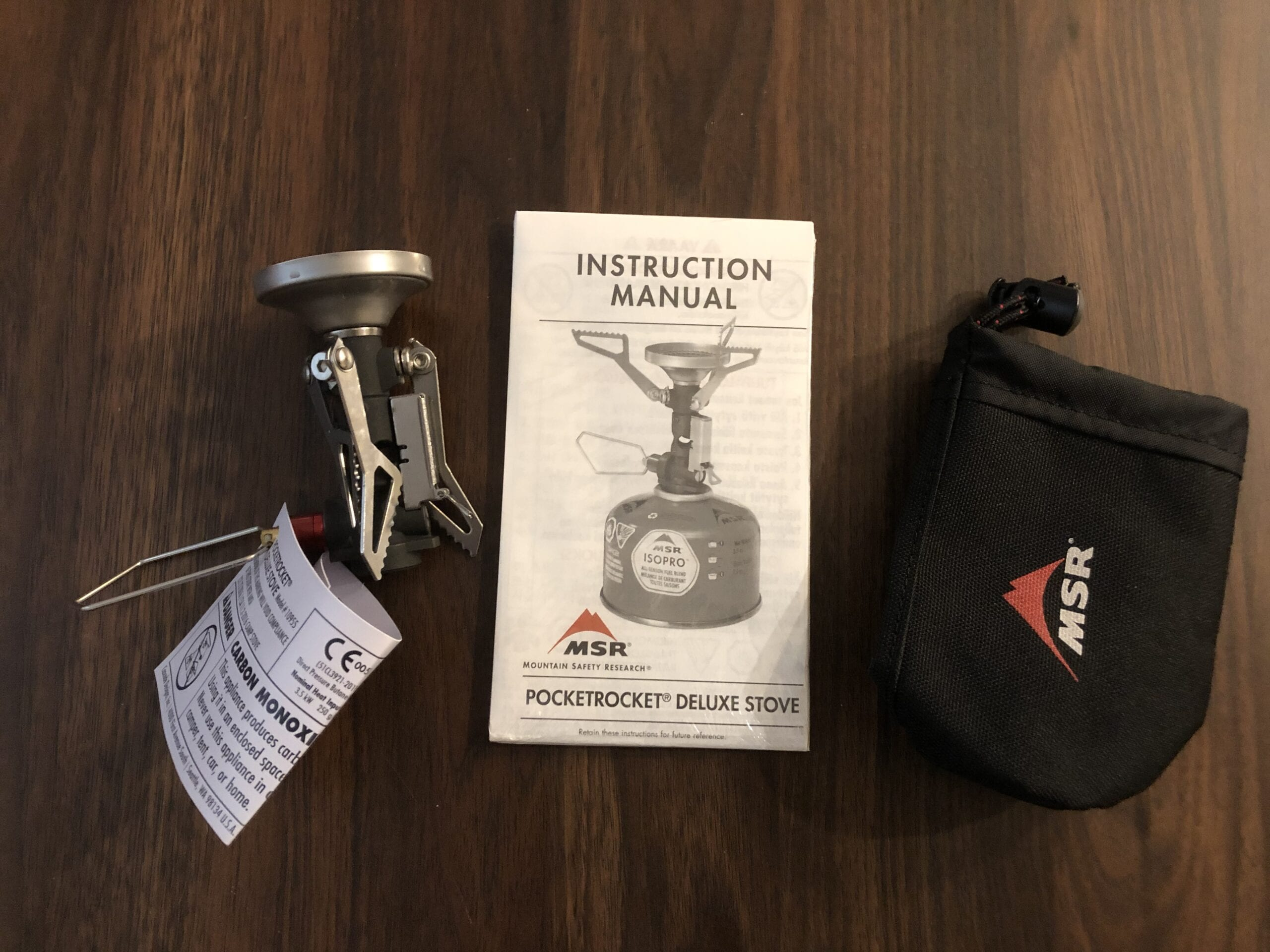 The MSR PocketRocket Deluxe stove with it's case and instructions.
