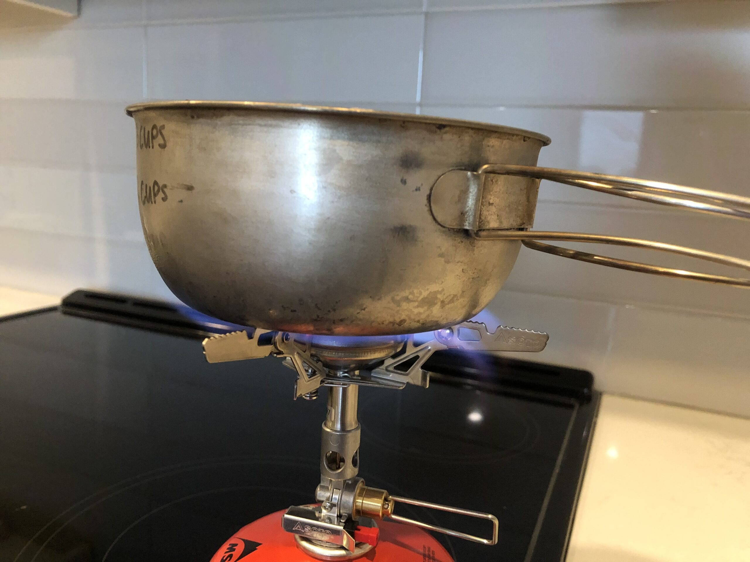 Soto WindMaster Stove attached to a fuel canister boiling a pot of water