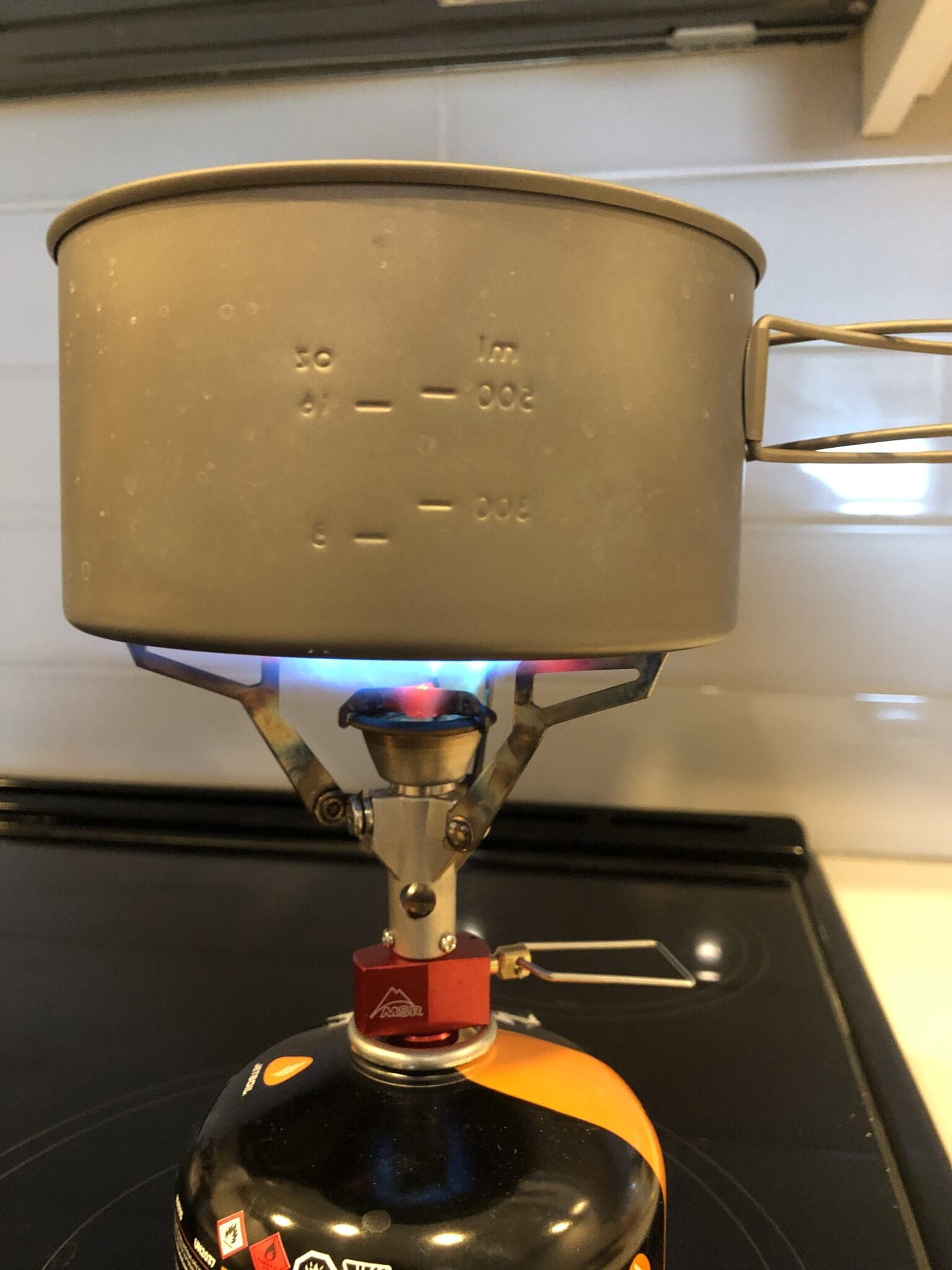 backpacking stove boiling water in pot