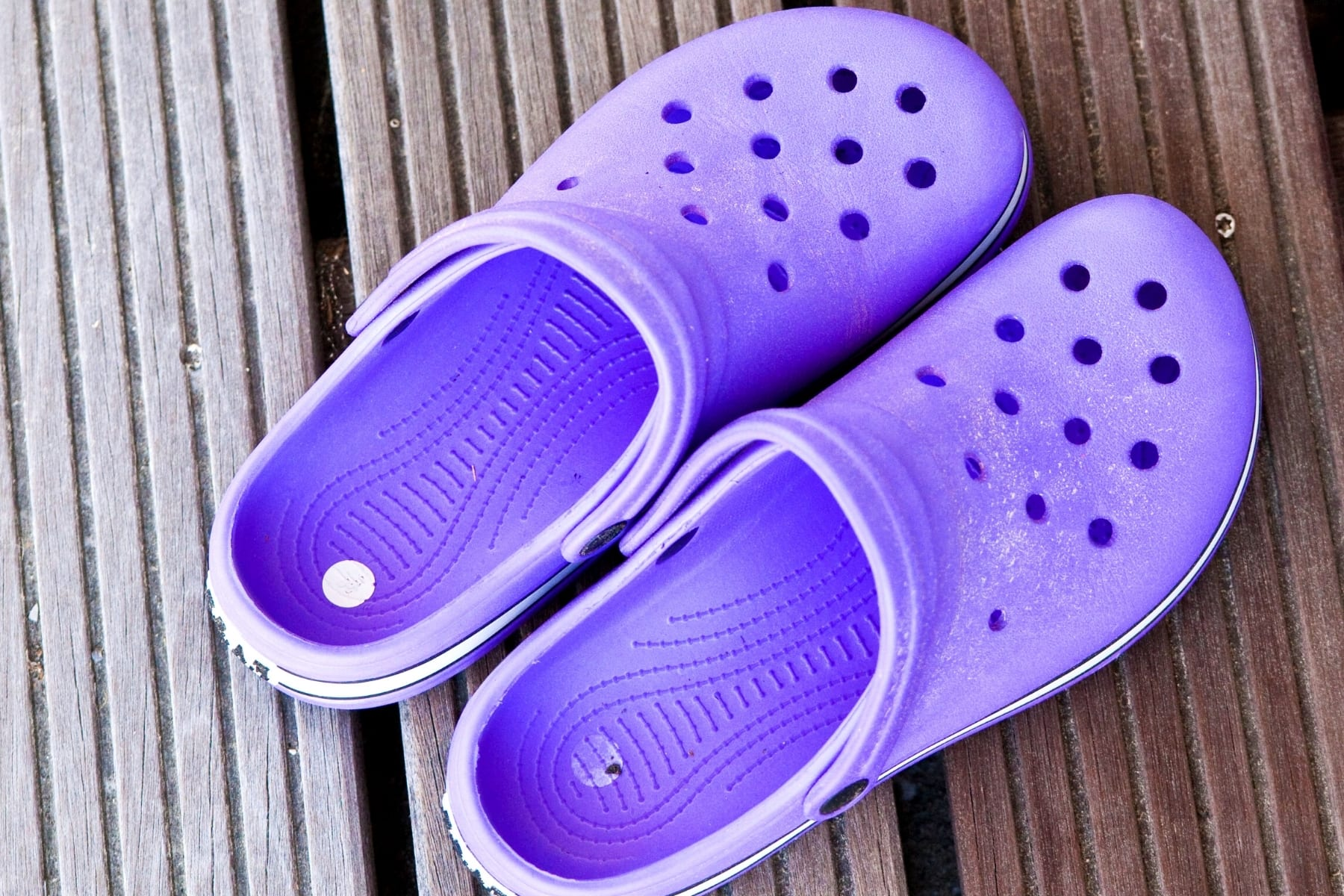 A pair of purple crocs shoes.