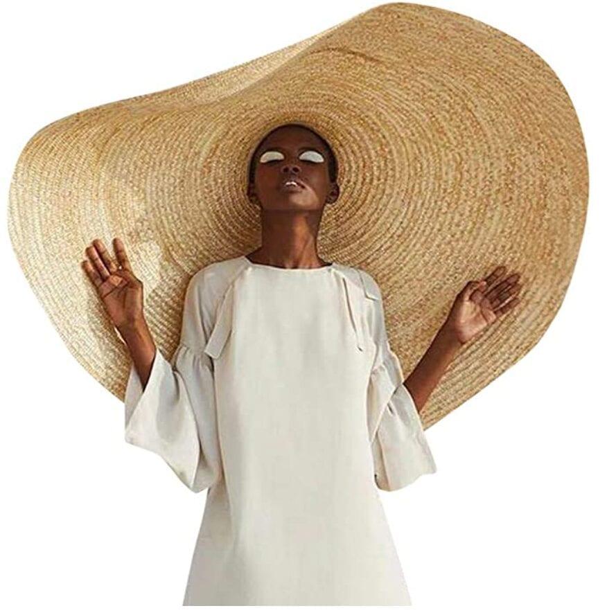 A woman wearing a big sun hat