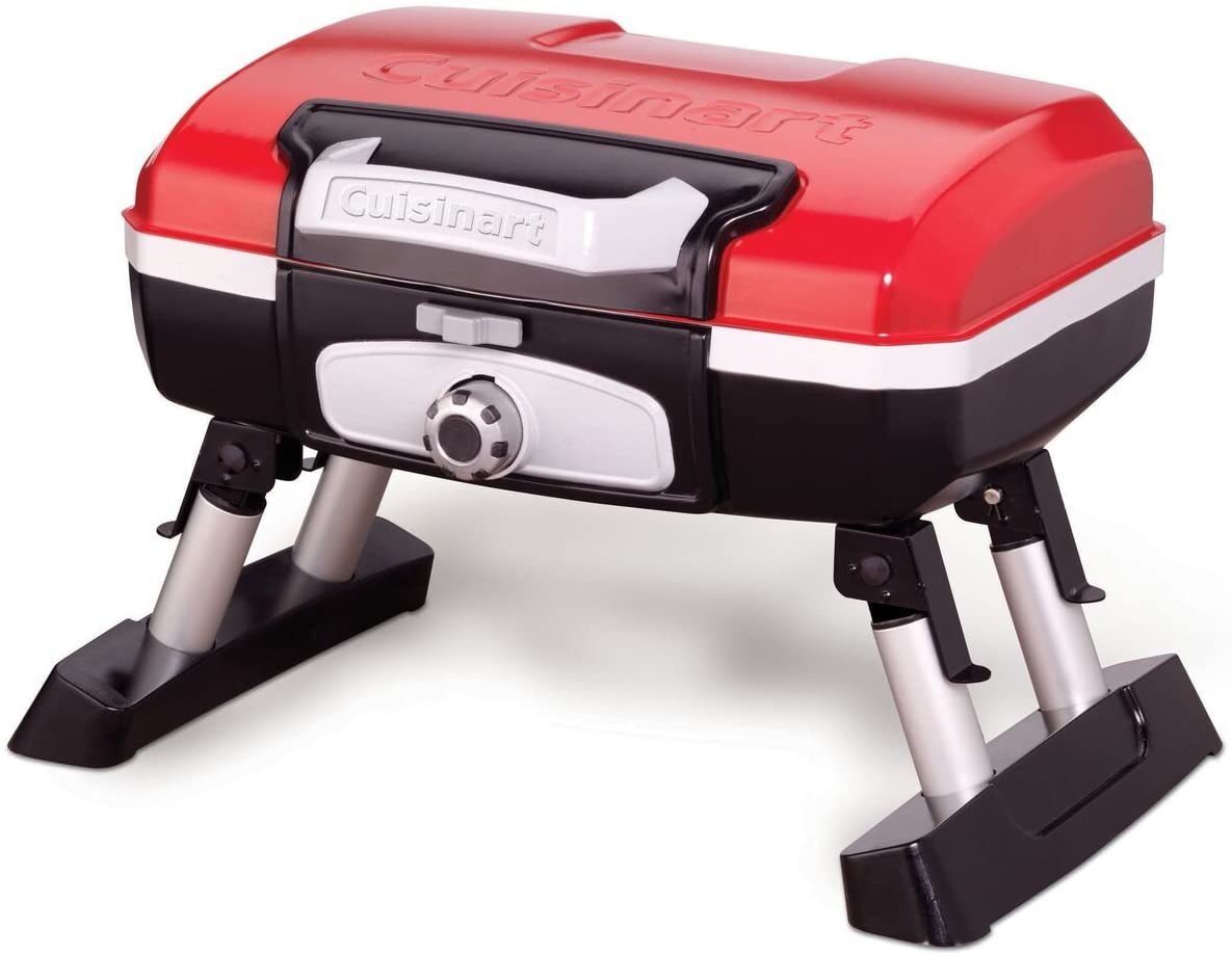 A portable red and black grill