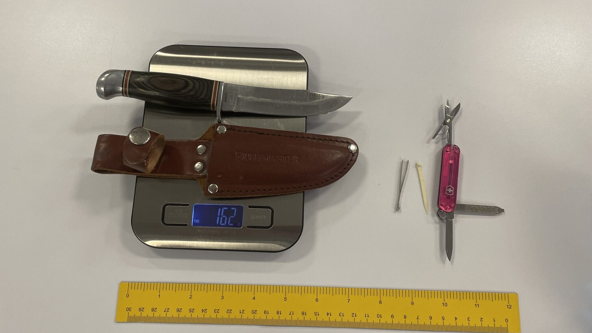 knives laying on scale