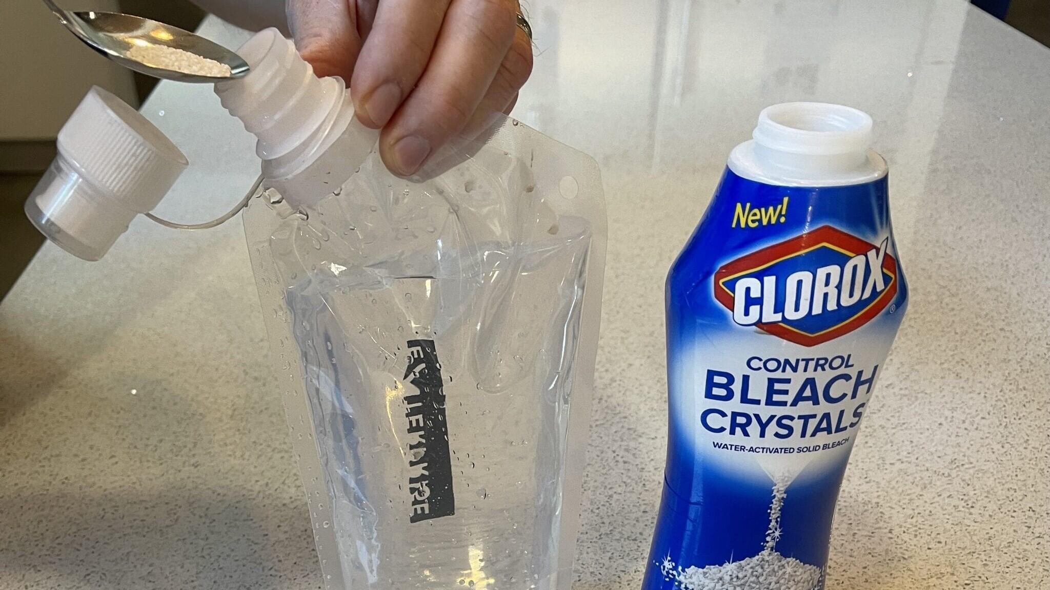 Clorox bleach crystals next to a water bottle.