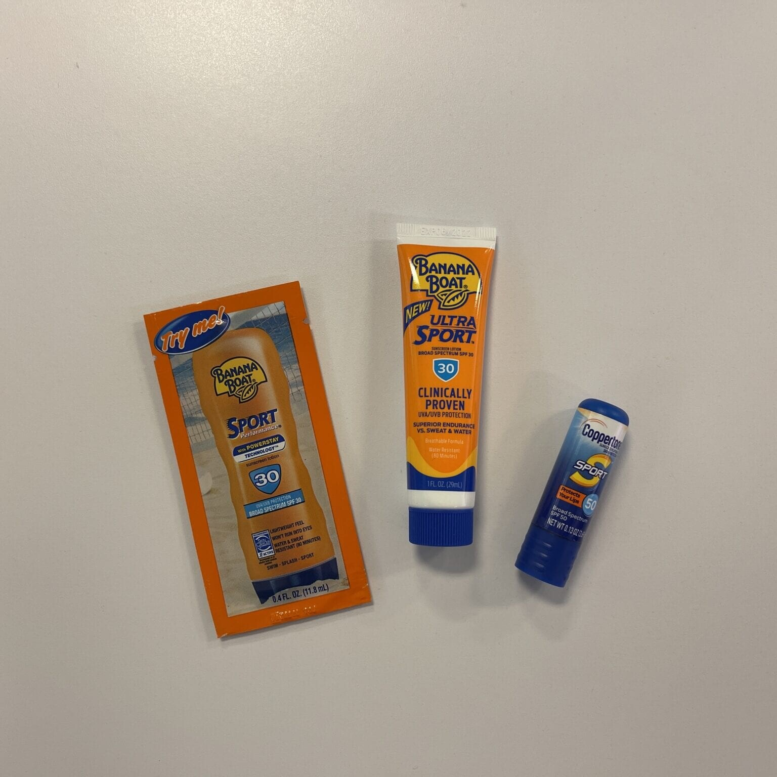 small samples of sunscreen laid on a table